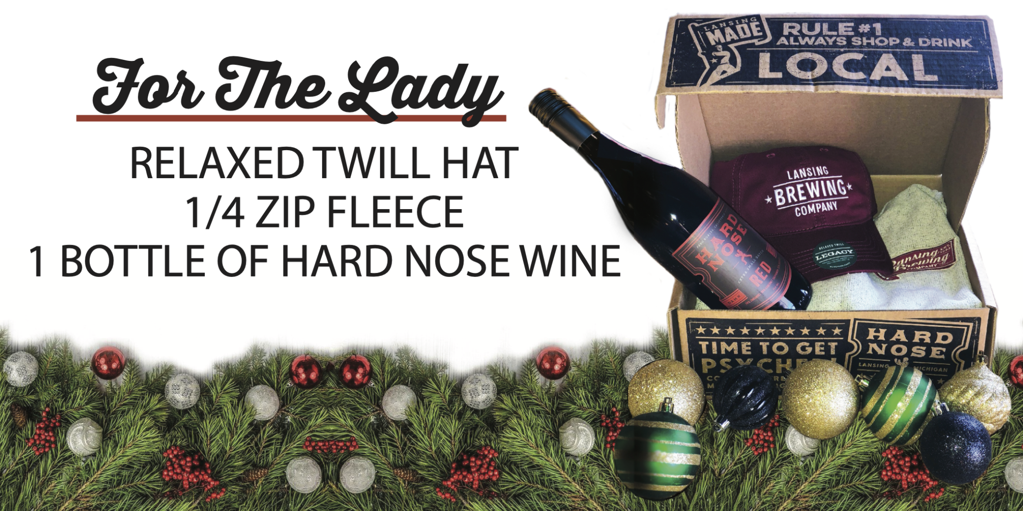 Holiday Gift Boxes at LBC. Twill hat, fleece, bottle of wine.